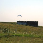 Paragliding at the top of the Downs, near the Devil's Dyke pub. The structure in the middle distance is a World War II pillbox.