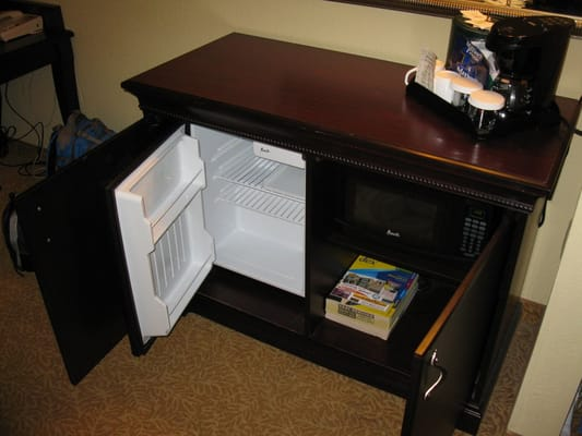 A Cabinet Opens To Reveal This Mini Fridge And A Microwave Oven Yelp