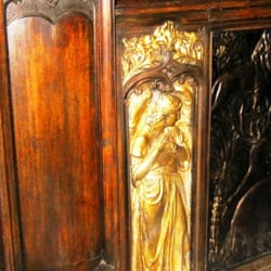 Holy Trinity, Sloane Square: Choir stall carvings, detail. The angel panels are by F W Pomeroy.
