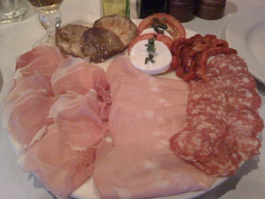 Antipasti platter of cured meats, grilled vegetables and mozzarella ...