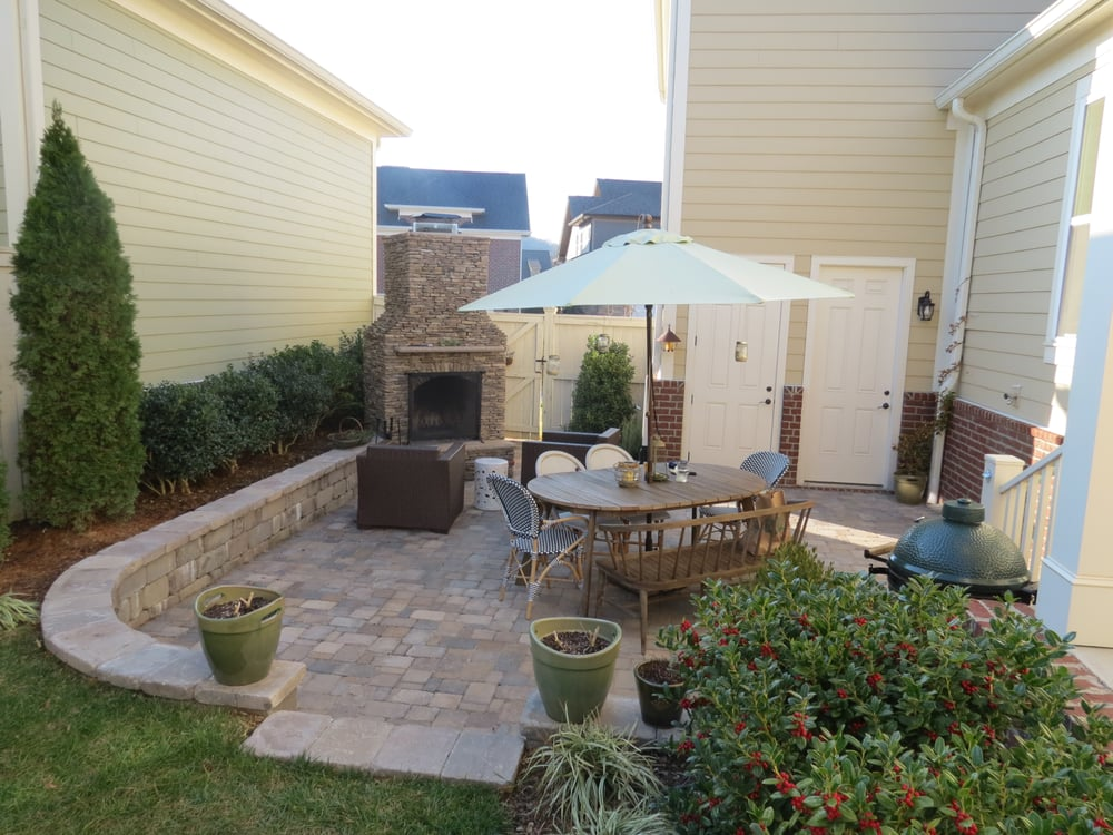 Outdoor living space with a natural stone fireplace