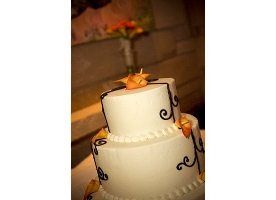 Wedding cake orange calla lilies black piping black and white made by