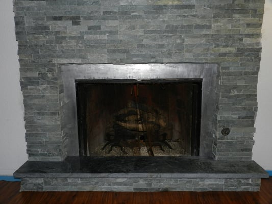 Ledge Stone tile installation around fireplace With