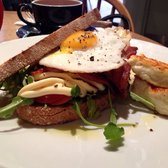 BERT - Toasted sourdough, organic streaky bacon, a fried egg, rocket, fresh tomato and aioli