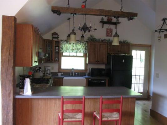Kitchen in 1 bedroom apt suite above garage yelp for Suite above garage