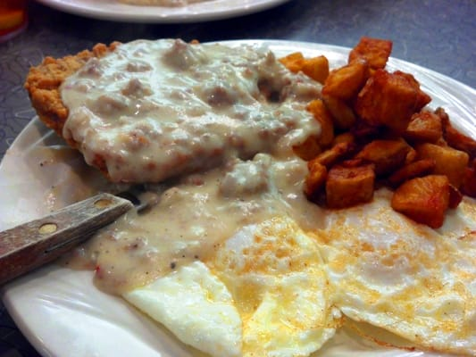 Chicken fried steak with country gravy, over-easy eggs, and home fries ...