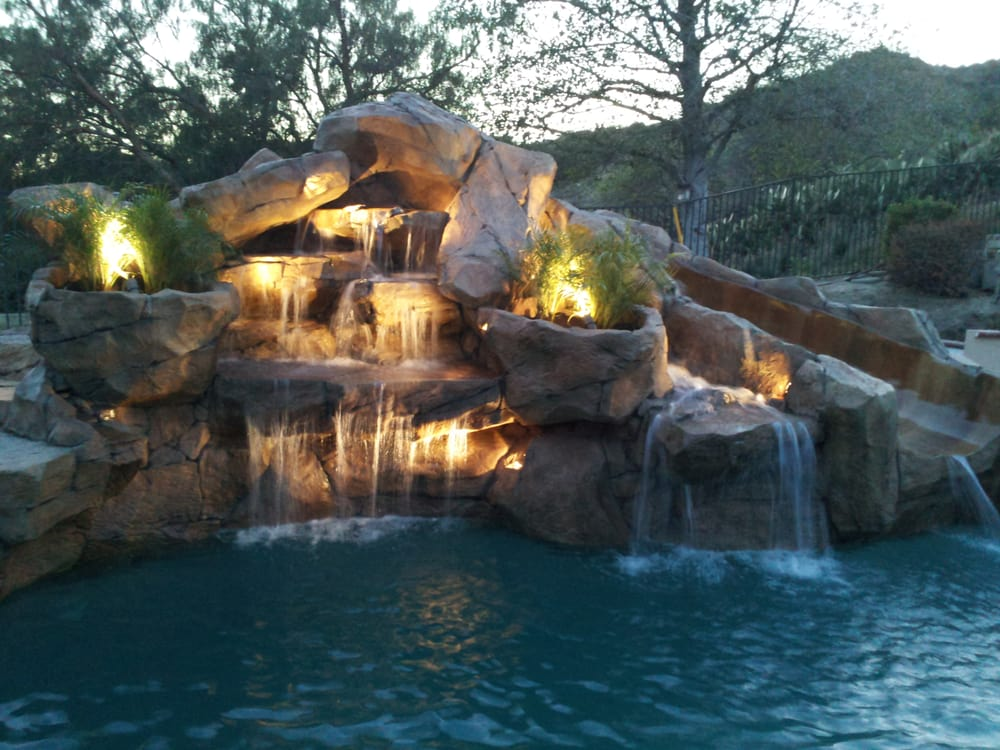 Rock waterfalls with slide added to swimming pool yelp for Swimming pools with slides and waterfalls