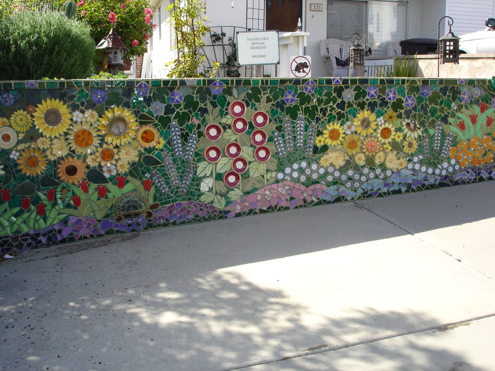 A creative and labor intensive mosaic garden wall yelp for Garden mosaics designs