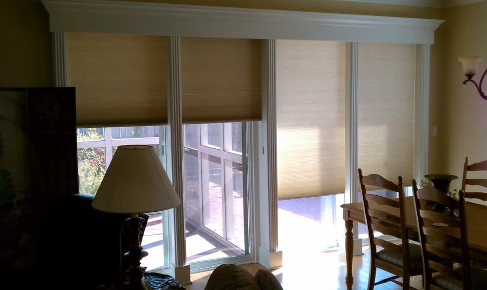 Continuous Cord Loop Cell Shades Over Double Sliding Glass