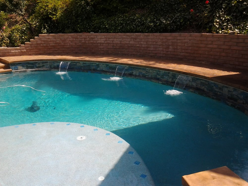Remodeled swimming pool with 3 sheer descents and raised - Fibreglass swimming pool bond beam ...
