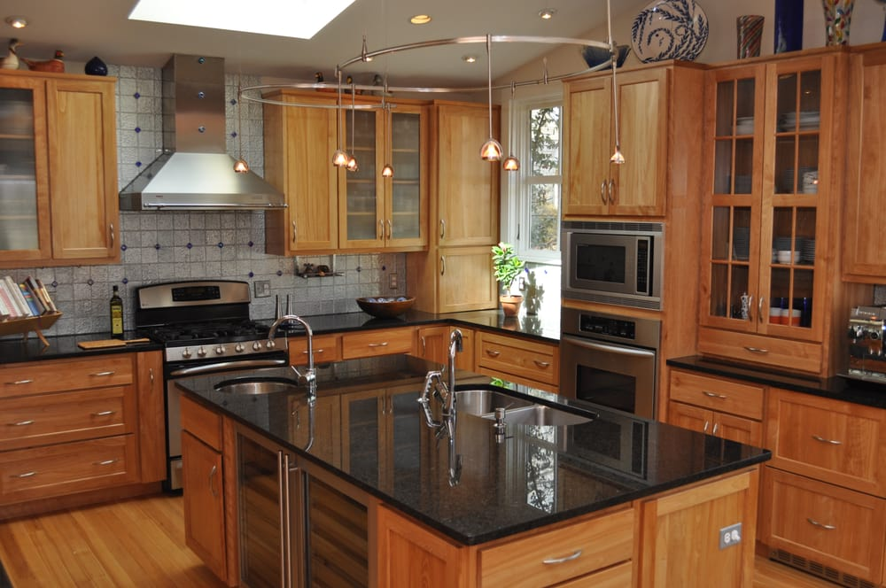 Custom Kitchen Addition with Maple cabinetry and black ... on What Color Granite Goes With Maple Cabinets  id=99661